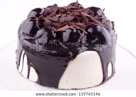 chocolate whole cake with profiteroles - stock photo