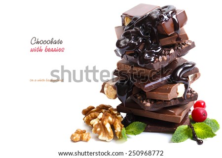 Chocolate with berries on a white background - stock photo