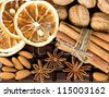 chocolate with cinnamon sticks, anise stars, nuts and sliced of dried orange. food background - stock photo
