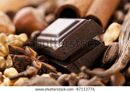 chocolate with coffee beans, spices and nuts - stock photo