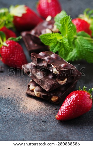 Chocolate with mint and strawberry, selective focus
