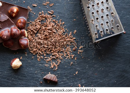 chocolate with nuts grated on a grater. close-up.  Top view  - stock photo