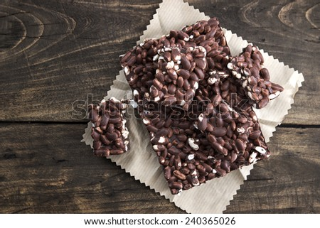 chocolate with puffed rice bar on wooden table,from above - stock photo