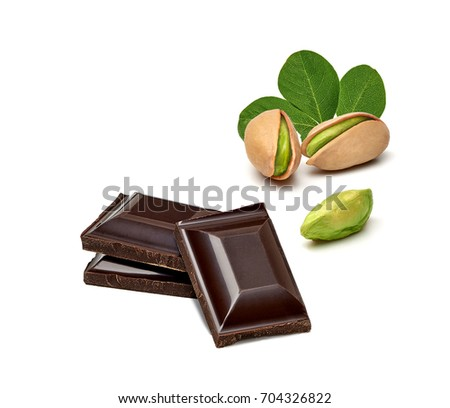 Chocolates and pistachios isolated on white background