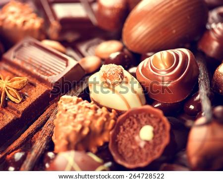 Chocolates background. Chocolate. Assortment of fine chocolates in white, dark, and milk chocolate. Variety of Praline Chocolate sweets - stock photo