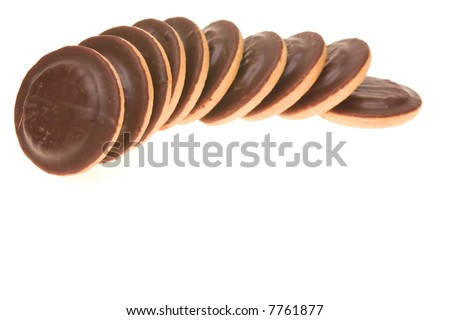 chocolates cakes in a row isolated on white