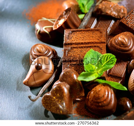 Chocolates. Chocolate sweets. Assortment of fine chocolates in dark and milk chocolate with vanilla and mint. Praline  - stock photo