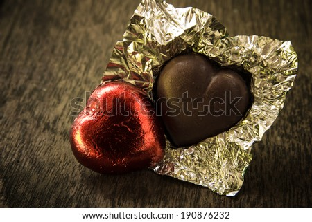 Chocolates, Heart shape on wooden background,love concept - stock photo