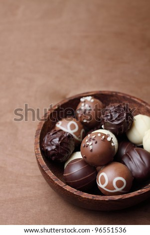 chocolates in a bowl of wood - stock photo