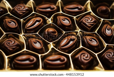 Chocolates in the box. Set of chocolate candies. Group of delicious chocolate pralines top view - stock photo