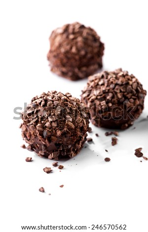 chocolates with crumbs close-up on white background - stock photo