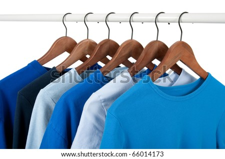 Choice of casual shirts on hangers, different tones of blue. Isolated on white. - stock photo