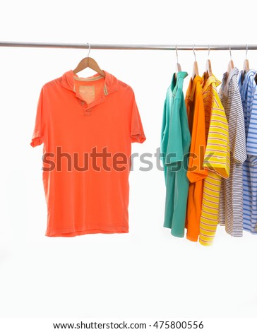 Choice of clothes of different colors on wooden hangers, isolated