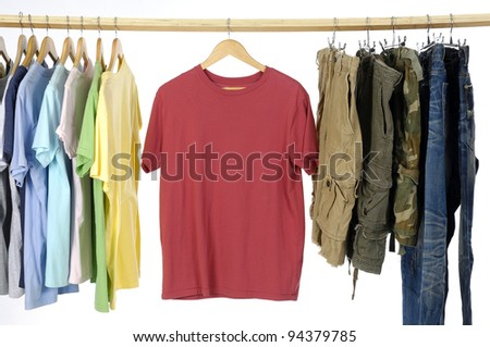 Choice of man clothes of different colors on wooden hangers and trousers