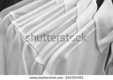 choice of polo shirts of white colors on hangers