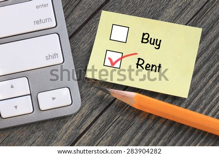 choice of rent decision, with desk background - stock photo