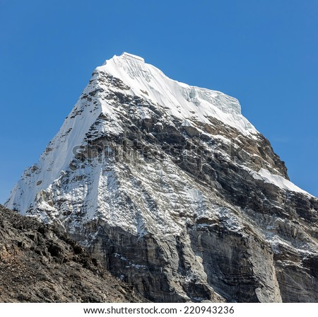 Chola peak (6069 m) in the area of Cho Oyu - Gokyo region, Nepal, Himalayas - stock photo