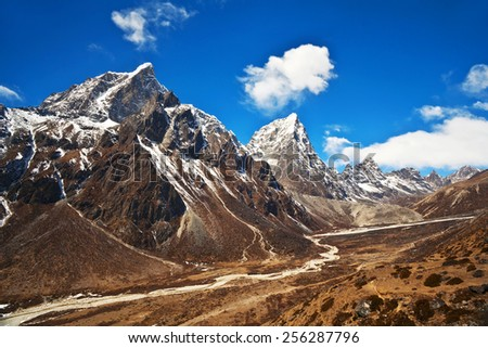 Cholatse (also known as Jobo Lhaptshan) and Taboche peaks view - mountain landscape in Sagarmatha National Park, Everest region, Nepal. - stock photo