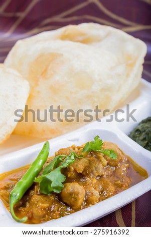 chole bhature with green chilie topping - stock photo