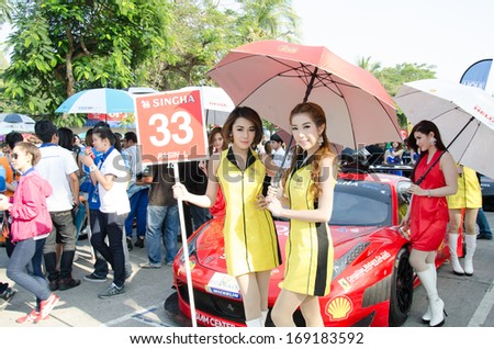 CHON BURI - DECEMBER 22: Unidentified model with Ferrari 458 Italia GT3 car on display at the Bangsaen Thailand Speed Festival 2013 Race 8 on December 22, 2013 at the Bangsaen street circuit, Thailand