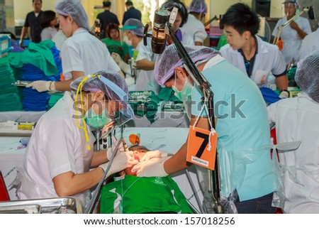 CHONBURI - OCTOBER 2 : Unidentified dentist from public hospital are in medical services  at wat yansangwararam temple on October 2,2013 in  Chonburi,Thailand. - stock photo