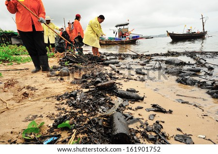 CHONBURI -OCTOBER 12: workers clean up oil from Bangsaen beach, Chonburi, Thailand on October 12, 2010. - stock photo
