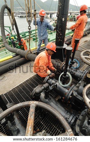 CHONBURI - OCTOBER 3: Workers preparing for loading crude oil  form ship to taker in Chonburi, Thailand on October3, 2008.