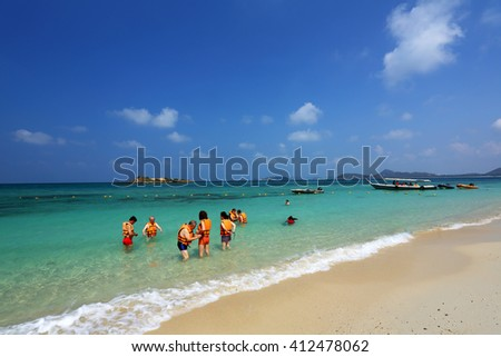 CHONBURI, THAILAND -APR 18: Unidentified many tourists play water in clean sea on Luklom beach of Koh Samaesarn on April 18, 2016 in Chonburi, Thailand.  It is an island with the care of naval base