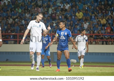 CHONBURI THAILAND - APRIL 24 : Pipob Onmo (R) in action during AFC CUP 2012 between Chonburi F.C. (blue) VS Yangon United (white) at Chonburi stadium on April 24,2012 in Chonburi,Thailand.