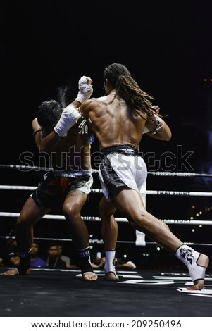 CHONBURI, THAILAND- APRIL 6 : Unidentified boxers compete in Thai Fight:Muay Thai World's Unrivaled Fight on  April 6, 2013 , at Chonburi ,  Thailand