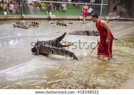 CHONBURI,THAILAND - AUGUST 16: crocodile show at crocodile farm on August 16, 2015 in Chonburi,Thailand. This exciting show is very famous among among tourist and Thai people - stock photo