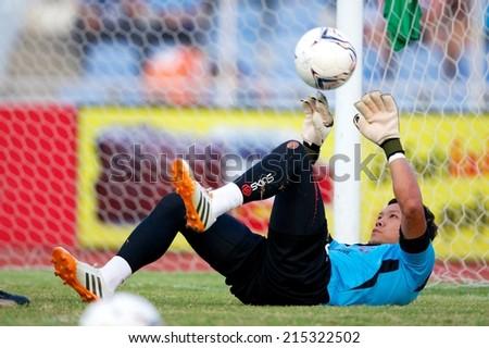 CHONBURI THAILAND-AUGUST20 :Goalkeeper Kawin Thamsatchanan of Muangthong utd.in action during The Thai Premier League, Chonburi F.C.and Muangthong utd. at Chonburi Stadium on Aug 20,2014 in Thailand. - stock photo