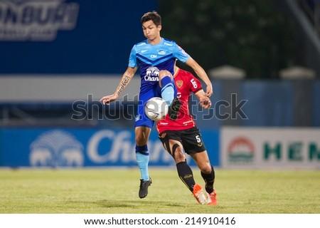 CHONBURI THAILAND-AUGUST20 :Juliano Mineiro (BLUE) of Chonburi F.C.in action during The Thai Premier League, Chonburi F.C.and Muangthong utd. at Chonburi Stadium on Aug 20,2014 in Thailand. - stock photo