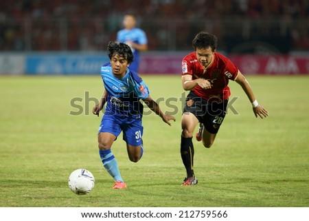 CHONBURI THAILAND - AUGUST 20 : Nurul Sriyankam (31) of Chonburi F.C. in action during Thai Premier League, Chonburi F.C. and Muangthong utd. at Chonburi Stadium on Aug 20, 2014 in Thailand. - stock photo