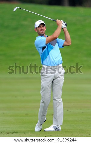 CHONBURI, THAILAND - DECEMBER 15:Charl Schwartzel of South Africa plays a shot during day one of the Thailand Golf Championship at Amata Spring Country Club on December 15, 2011 in Chonburi, Thailand.