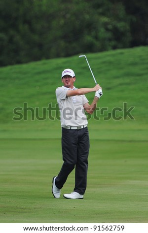CHONBURI, THAILAND - DECEMBER 15:Davic GLEESON of Australia plays a shot during day one of the Thailand Golf Championship at Amata Spring Country Club on December 15, 2011 in Chonburi, Thailand.