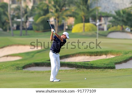 CHONBURI,THAILAND - DECEMBER 15: John Parry of England plays a shot during day one of the Thailand Golf Championship at Amata Spring Country Club on December 15, 2011 in Chonburi, Thailand.