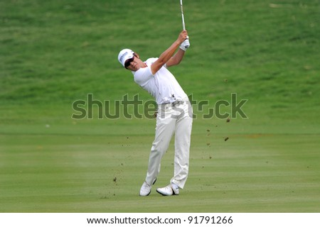 CHONBURI,THAILAND - DECEMBER 15: Kim Kyung-Tae of Korea (South)plays a shot during day one of the Thailand Golf Championship at Amata Spring Country Club on December 15, 2011 in Chonburi, Thailand.