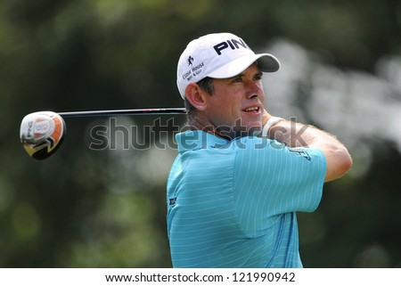 CHONBURI,THAILAND-DECEMBER 6:Lee Westwood of England hits a shot during hloe 2 day one of the Thailand Golf Championship at Amata Spring Country Club on Dec 6,2012 in ,Thailand. - stock photo