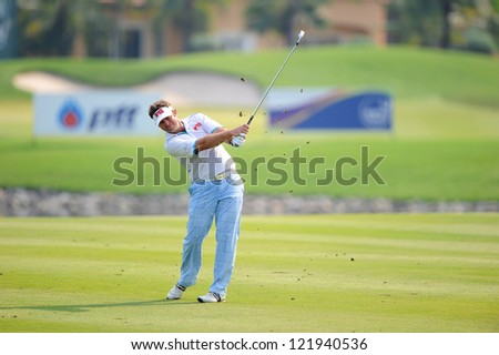 CHONBURI,THAILAND-DECEMBER 6:Scott Barr of Australia hits a shot during hole 2 day one of the Thailand Golf Championship at Amata Spring Country Club on December 6, 2012 in Chonburi,Thailand.