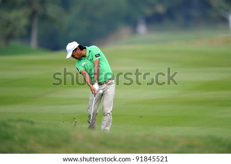 CHONBURI,THAILAND - DECEMBER 15:Shingo KATAYAMA of Japan plays a shot during day one of the Thailand Golf Championship at Amata Spring Country Club on December 15, 2011 in Chonburi, Thailand.