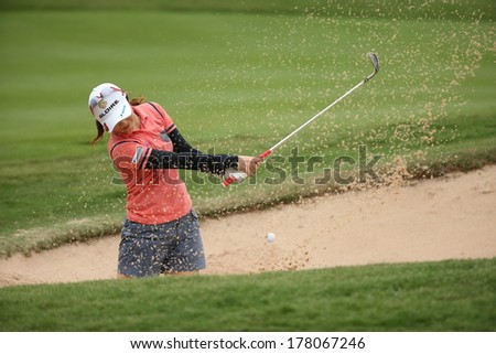 Chonburi, Thailand - FEB 21:Shinobu Moromizato of Japan participate in a Honda LPGA Thailand 2014 at Siam Country Club Pattaya Old Course on February 21, 2014 in Chonburi, Thailand.