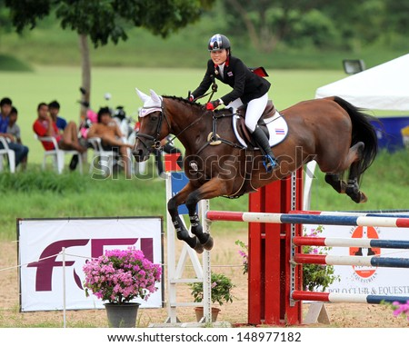 CHONBURI, THAILAND - JULY 28:Thanaporn Chavatanont of Thailand with Painters Peer in action during 1st FEI Asian Eventing Championships 2013 at Thai Polo&Equestrian Club on July 28, 2013 in Chonburi, Thailand. - stock photo