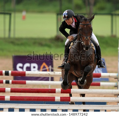 CHONBURI, THAILAND - JULY 28:Weerapat Pitakanonda of Thailand with Monarchs Royal Touch in action during 1st FEI Asian Eventing Championships 2013 at Thai Polo Club on July 28, 2013 in Chonburi, Thailand. - stock photo