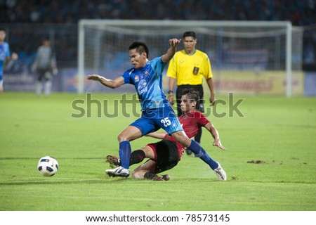 CHONBURI THAILAND- JUN 4 : C.Intakam (L) in action during Thai Premier League (TPL) between  Chonburi Fc (Blue) vs Muang Thong utd (Red) on Jun 4, 2011 at   Chonburi Stadium,Chonburi, Thailand