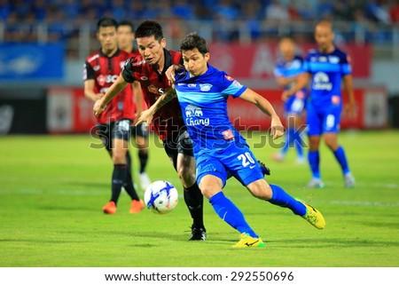 CHONBURI THAILAND - JUNE 25 : Juliano M Fernandes (20) of Chonburi F.C. in action during Thai Premier League, Chonburi F.C. and Muangthong utd. at Chonburi Stadium on Jun 25, 2015 in Thailand. - stock photo