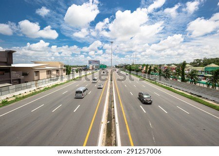 CHONBURI-THAILAND - JUNE 28 : The wide lanes with high speed cars on the motorway from Bangkok to Pattaya on June 28,2015  - stock photo