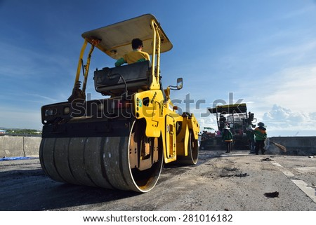 CHONBURI, THAILAND - MAY 21, 2015: Heavy Vibration roller at asphalt pavement works in Thailand. - stock photo