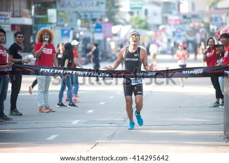 CHONBURI, THAILAND-OCTOBER 17, 2015 : Unidentified triathlon competition in Pattaya Triathlon ,Thailand Tri-League Tour Series 2015 on Pattaya beach, Chonburi Province in Eastern of Thailand. - stock photo