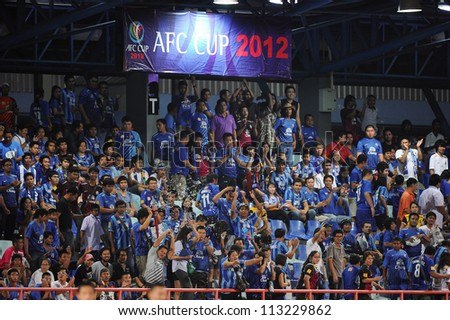 CHONBURI,THAILAND-SEP18:Unidentifie fan of Chonburi fc.supporters during AFC CUP quarter finals between Chonburi fc.and Al Shorta (SYR) at Chonburi Stadium on Sep18,2012 in Thailand - stock photo